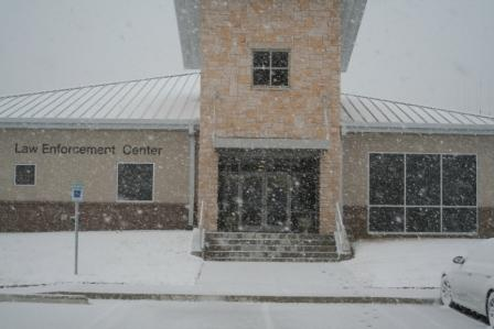 Law Enforcment building durring a recent snow.